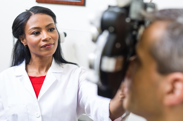 An optometrist examining a patient's eyes.