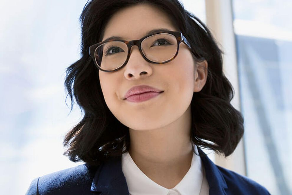 Young business woman wearing glasses.